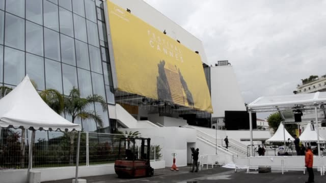 workers set up the official poster of the 69th cannes film festival on the facade of the palais des congres in windy conditions - festival poster stock videos & royalty-free footage