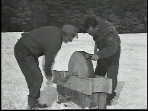 workers sharpening axe on a grindstone / men chopping wood in the the snow / man operating radial saw / workers stacking logs - 1934 stock videos & royalty-free footage