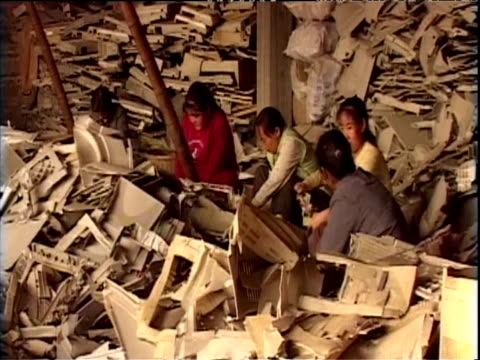 workers sort and transport electronic waste china; 11 nov 04 - 2000s style stock videos & royalty-free footage