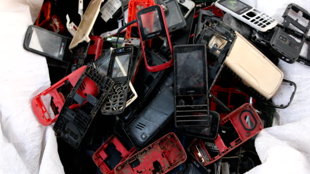 workers sort out usable goods from used mobile phones in dhaka, bangladesh on november 04, 2019. - still life stock videos & royalty-free footage