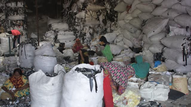 workers sorting through garment leftovers at a godown in dhaka, bangladesh on march 15, 2021. recycling of waste raw materials left by garment... - textile stock videos & royalty-free footage