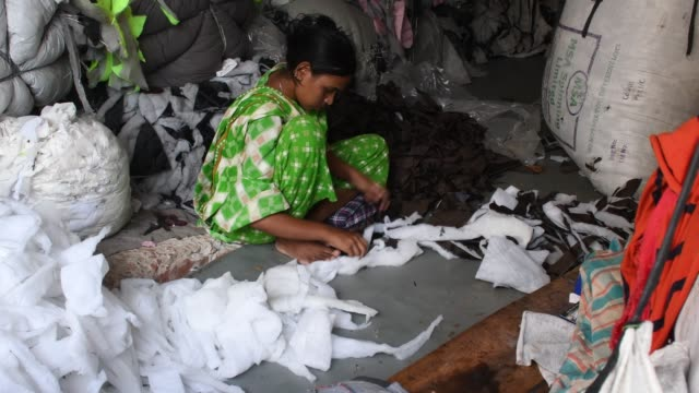 workers sorting through garment leftovers at a jhoot godown in dhaka recycling of waste raw materials left by garment factories has emerged as a good... - rubbish dump stock videos & royalty-free footage