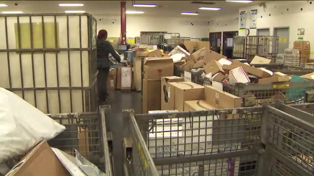 workers sorting through mail at post office. - post office stock videos & royalty-free footage