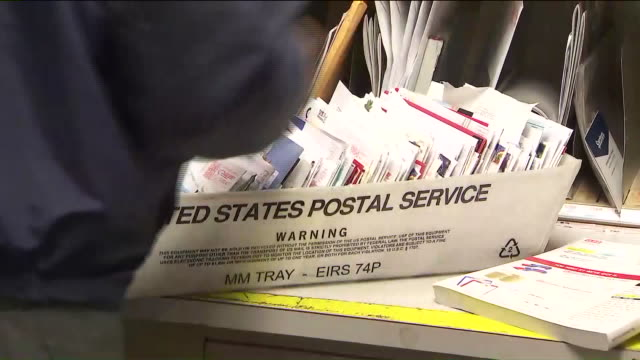 ktla workers sorting through mail at post office - post office stock videos & royalty-free footage