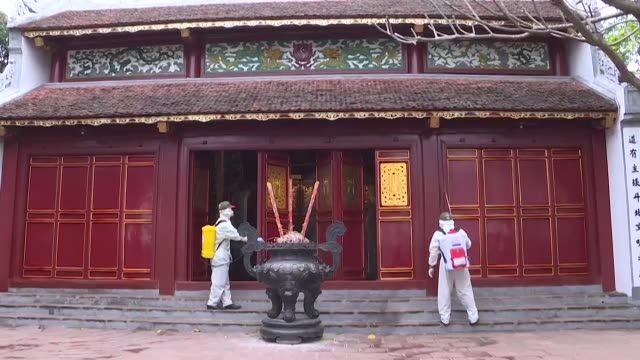 workers spray disinfectant at historical sites in hanoi amid coronavirus fears - north vietnam stock videos & royalty-free footage