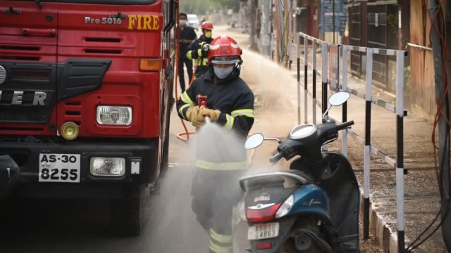 workers spray disinfectants amid concerns over the spread of the covid-19 disease - firefighter stock videos & royalty-free footage