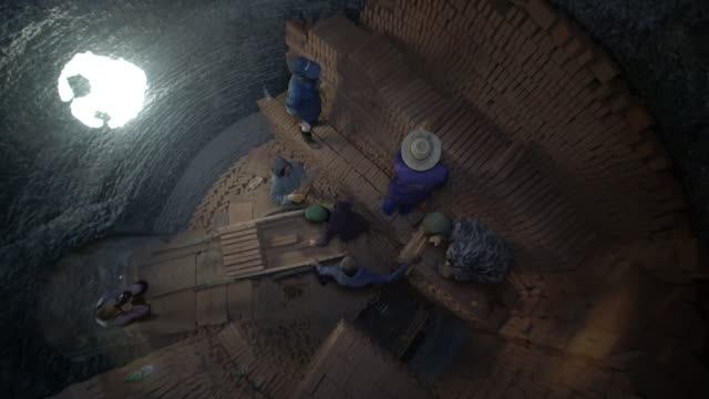 workers stack red bricks in traditional brick kilns ready to be burned - brick stock videos & royalty-free footage