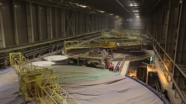 workers stand on the rim of a salt sludge thickening silo under construction at the usolskiy potash complex, operated by eurochem group ag, at the... - quarry stock videos & royalty-free footage