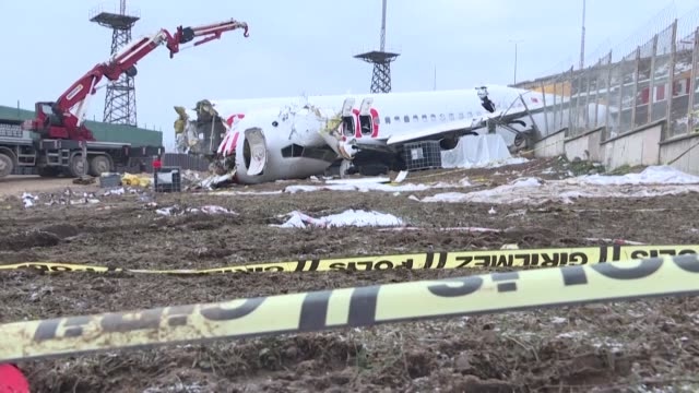 stockvideo's en b-roll-footage met workers start removing the wreckage of the pegasus airlines airplane in istanbul four days after it skidded off the runway upon landing at the sabiha... - start en landingsbaan