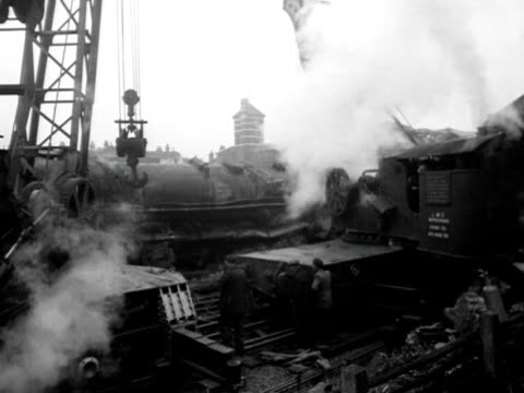workers start to clear wreckage from the train tracks at harrow and wealdstone station following a fatal crash involving three trains. - harrow stock videos & royalty-free footage