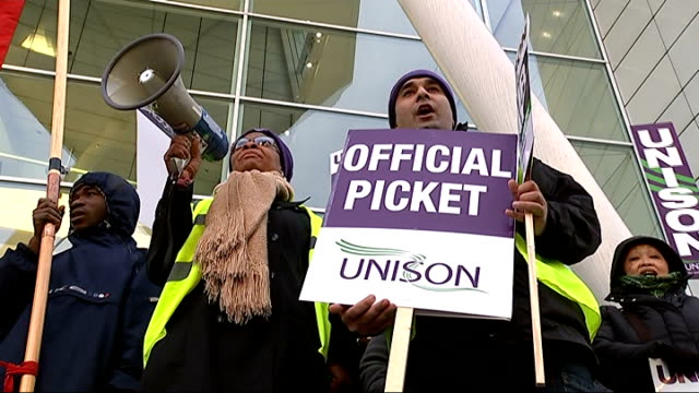 nhs workers strike over pay dispute england london ext various shots nhs workers on strike in pay dispute at offical picket with unison banners and... - streikposten stock-videos und b-roll-filmmaterial