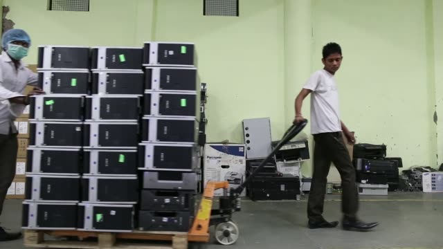 workers transport refurbished computers at the attero recycling pvt facility in the raipur industrial area of bhagwanpur in roorkee uttarkhand india... - e waste stock videos & royalty-free footage