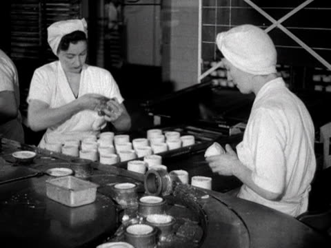 workers trim individual meat pies in a pie factory 1955 - savoury food stock videos & royalty-free footage