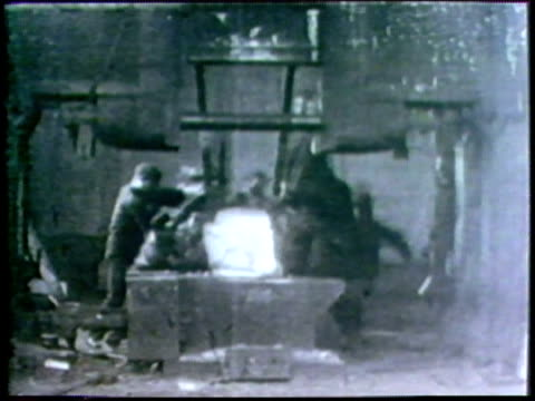 1973 b/w ws workers turning steel under large steel press/ usa/ audio - steel worker stock videos & royalty-free footage