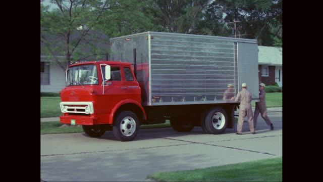 ms zo workers unloading boxes from truck in suburban neighborhood / united states - lastzug stock-videos und b-roll-filmmaterial