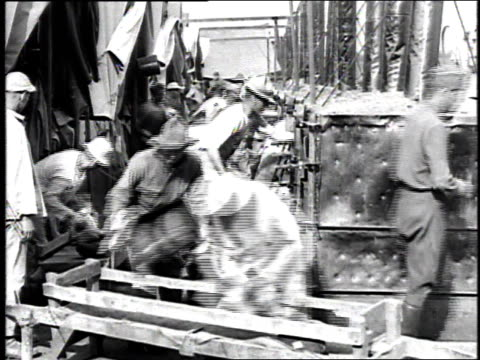 ms workers unloading bread loaves from large ovens into carrying trays / france - loaf stock videos & royalty-free footage