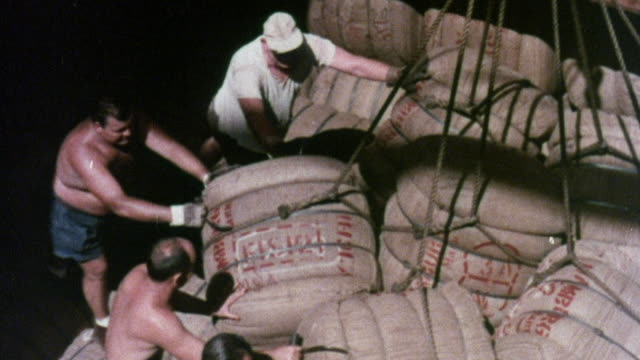 1973 montage workers unloading crates from ship, trucks delivering products / united kingdom - 1973 stock videos and b-roll footage