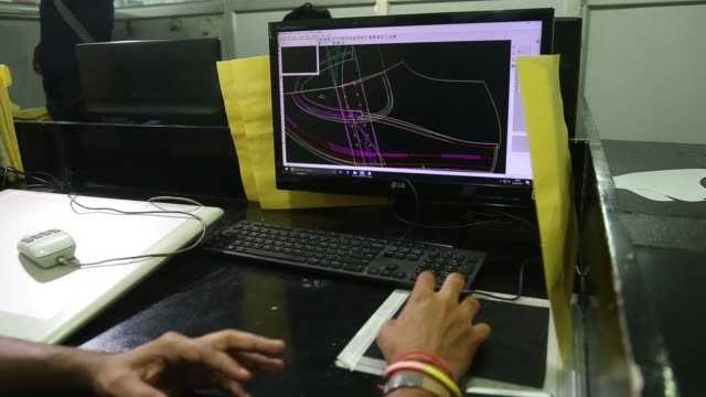 Workers use computeraided design and computeraided manufacturing software to work on shoe designs at a Virola Shoes Pvt manufacturing facility in...