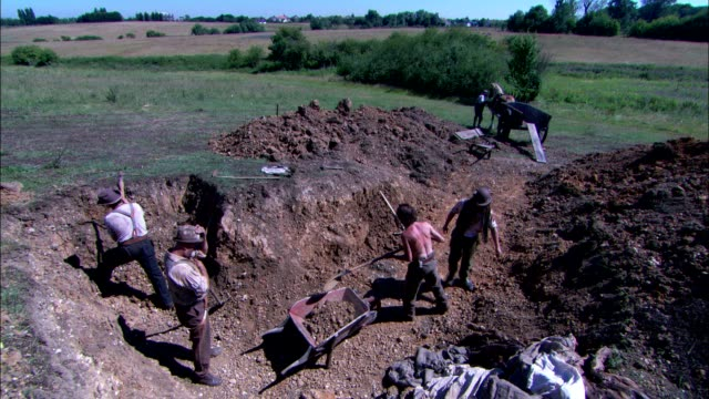 workers use hand tools to dig a trench. - historical reenactment stock videos and b-roll footage