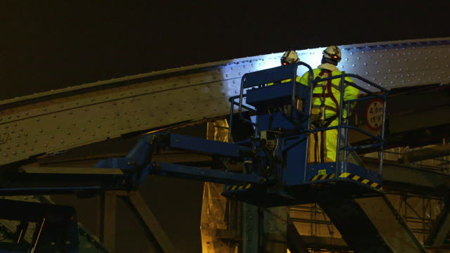 ms la workers using cherry picker at north circular road / london, england, united kingdom - ハーネス点の映像素材/bロール