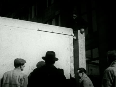 workers w/ large wooden gate open closing checking w/ level decorations vs artists artisans painting crests royal crown banners for display in streets - 1953 stock videos and b-roll footage
