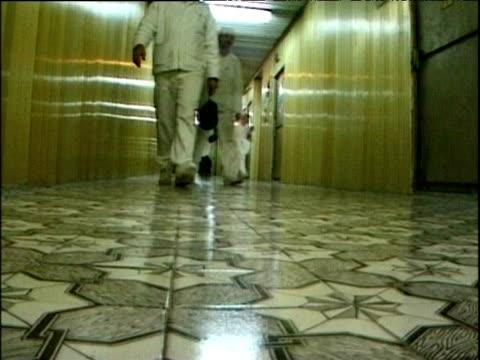 Workers walking down corridor at Chernobyl Reactor number 3 Ukraine