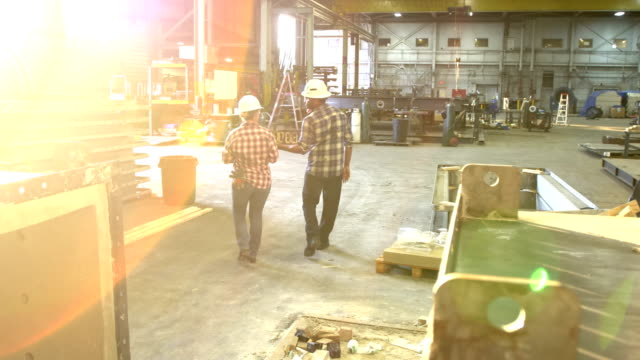 workers walking through metal fabrication shop - metal industry stock videos & royalty-free footage