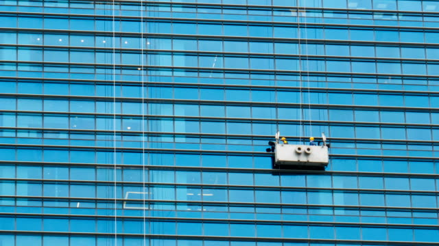 workers washing windows in the office building. - tower stock videos & royalty-free footage