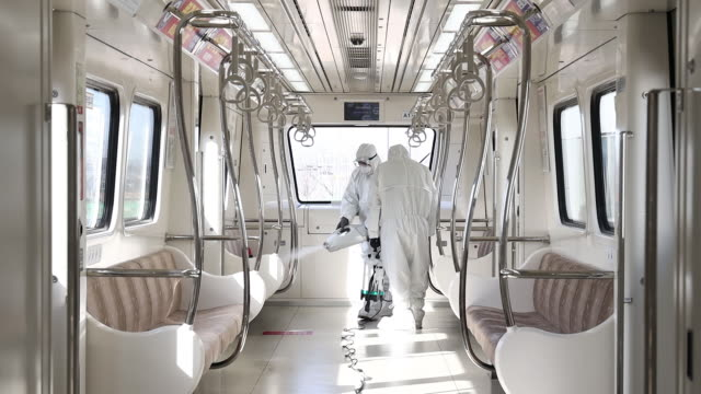 workers wearing protective suits spray disinfectant onto subway train operated by gimpo goldline co in gimpo gyeonggi province south korea on... - coronavirus stock videos & royalty-free footage