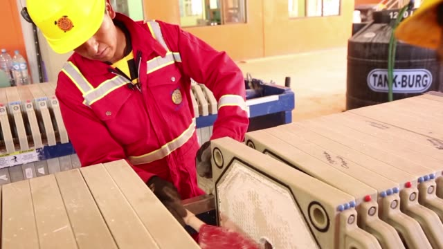 ' Workers wears protective clothing while making lithium at the state mining company Comibol's lithium production complex in Llipe Bolivia on the...