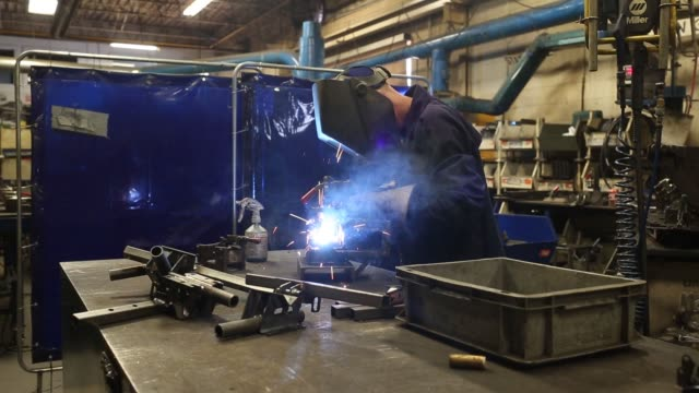 Workers weld metal at the Argo factory a division of Ontario Drive Gear Ltd in New Hamburg Ontario Canada on Thursday June 8 2017 Shots wide shot of...