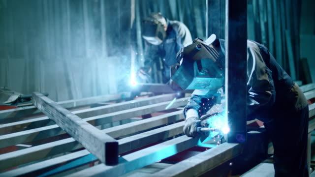 slo mo ld workers welding metal frames - welder stock videos & royalty-free footage