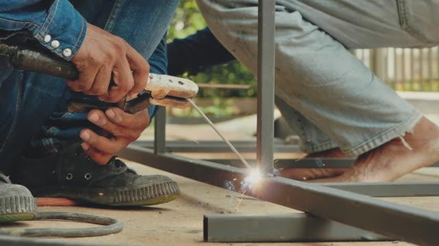 workers welding metal - welding torch stock videos & royalty-free footage
