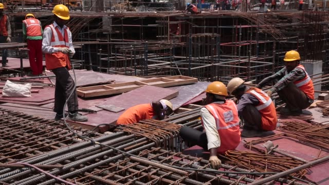 workers work with steel at the construction zone of majestic metro station developed by bangalore metro rail corp in bengaluru india on saturday may... - metal blend stock videos and b-roll footage