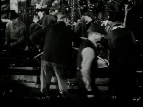 1940 WS Workers working at assembly line conveyor belt / United States