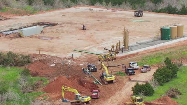 WS AERIAL ZI Workers working at pipeline construction site for Natural Gas Pipeline Construction in Dewey county / Oklahoma, United States