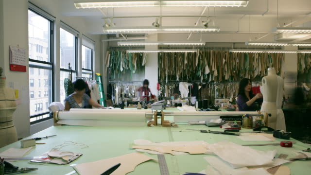ms zo t/l workers working in fashion designer's workshop / new york city, new york, usa  - textile mill stock videos & royalty-free footage