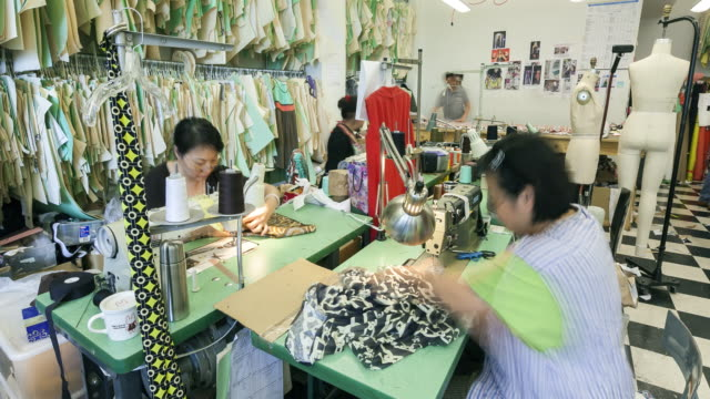 WS T/L TU Workers working in fashion designer's workshop / New York City, New York, USA
