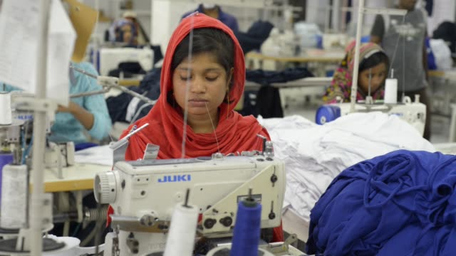 workers working inside the factory where they produce ready made garments of different brands for european market at narayanganj, bangladesh on... - textile industry stock videos & royalty-free footage
