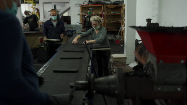 workers working on coal for hookah production line in factory - production line worker stock videos & royalty-free footage