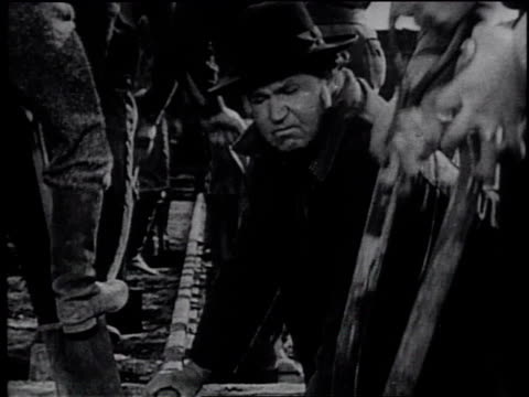 1945 reenactment workers working on railroad construction / united states - frank capra video stock e b–roll