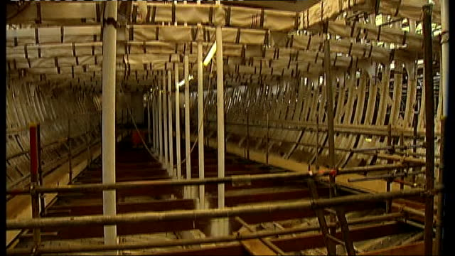 int workers working on renovation of the teak planking of the ship skeleton of the ship richard doughty interview sot - allenamento a corpo libero video stock e b–roll