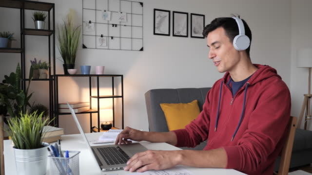 working and studying from home. vlogger in front of laptop - working in remote location stock videos & royalty-free footage