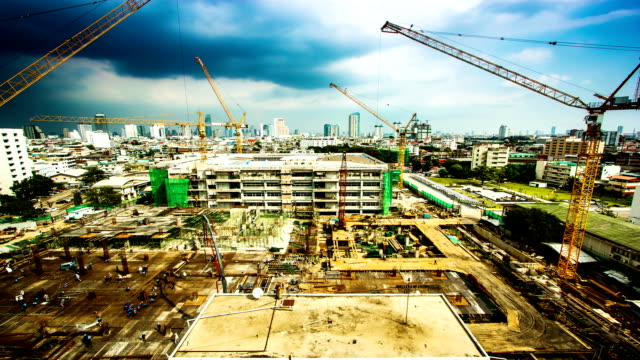 working at big construction site with crane - building activity stock videos & royalty-free footage