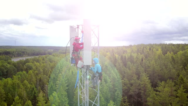 working at height - telecommunications equipment stock videos and b-roll footage