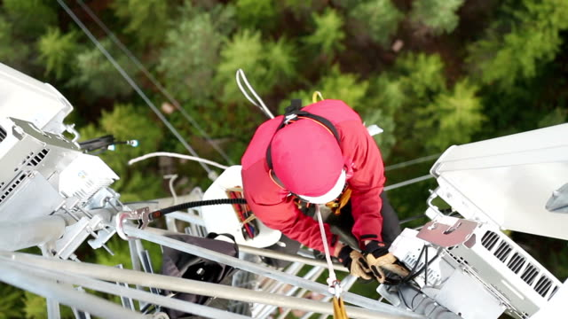 working at height - safety harness stock videos & royalty-free footage