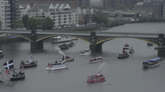 working boats in the diamond jubilee flotilla on the river thames - flotilla stock videos & royalty-free footage