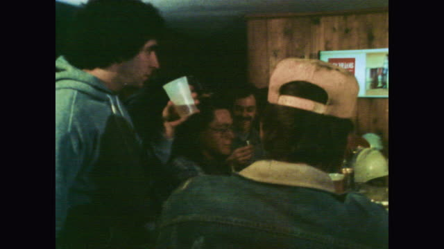 1978 working class men laughing, drinking and smoking at bar - smoking issues stock videos & royalty-free footage