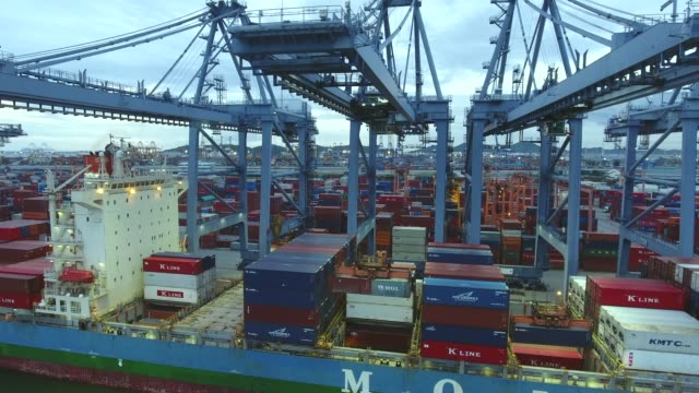Working Crane and Container Ship in the Harbor, International Cargo Port, Aerial Video