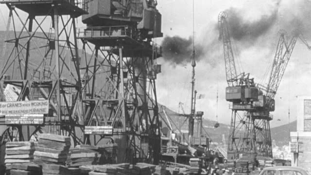 1949 montage working cranes, miner drilling into rock, and mine production workers sorting through mineral ore on a conveyor belt / united kingdom - 炭鉱点の映像素材/bロール